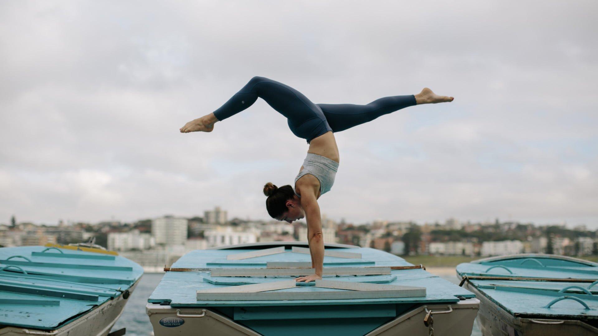 Kat Clayton Handstand Boat in Bondi