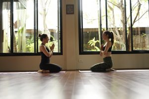 Kat Clayton yoga mentorship with yoga student in Thailand at retreat centre on a yoga retreat