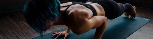 woman doing chatturanga pushups