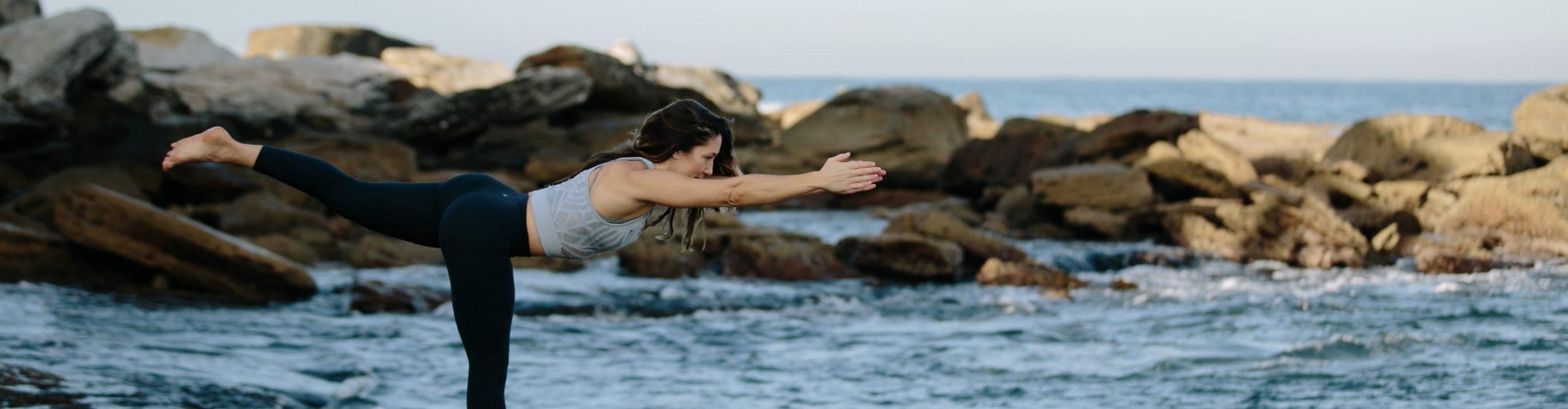 Kat Clayton yoga balancing in Warrior III