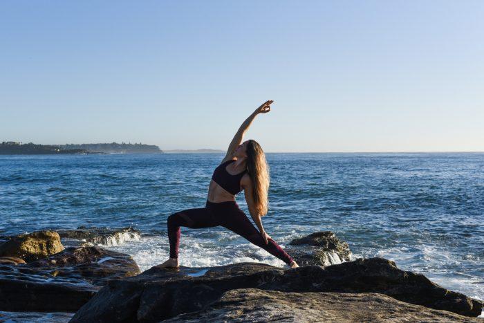Kat Clayton Yoga reverse warrior ocean yogi